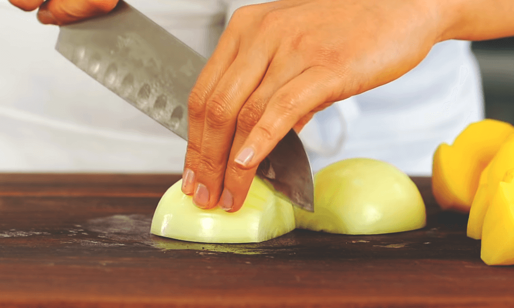 cutting onion for whole chicken roasted