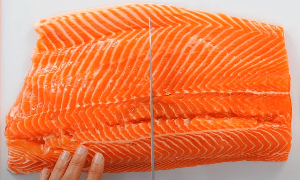 Cutting salmon fillet