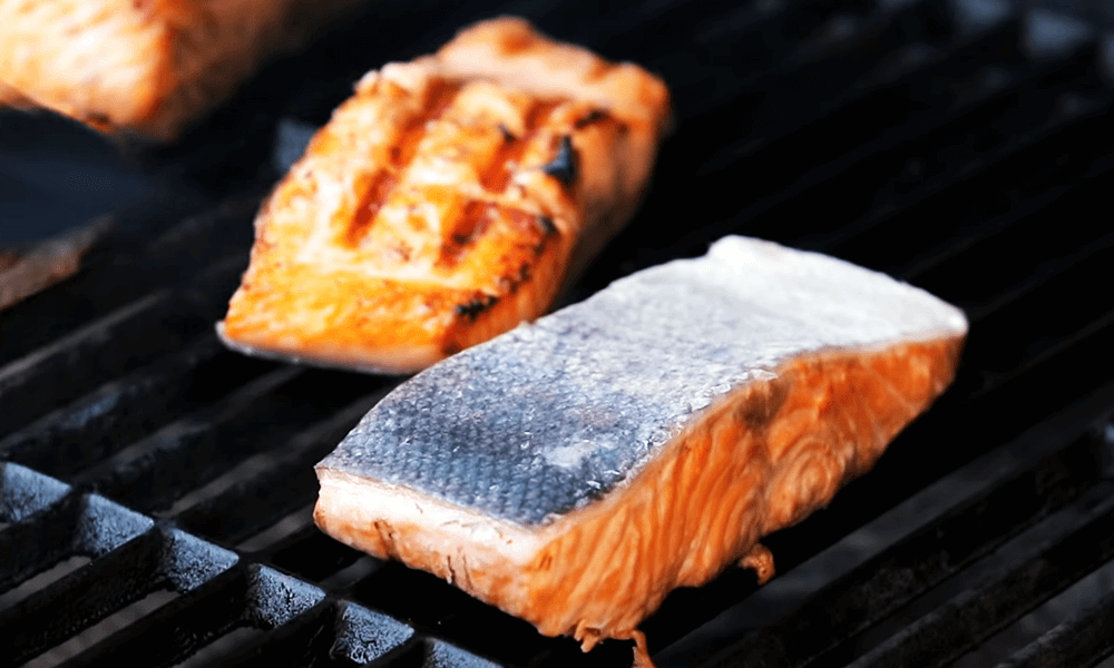 place the salmon into the hot grill other side