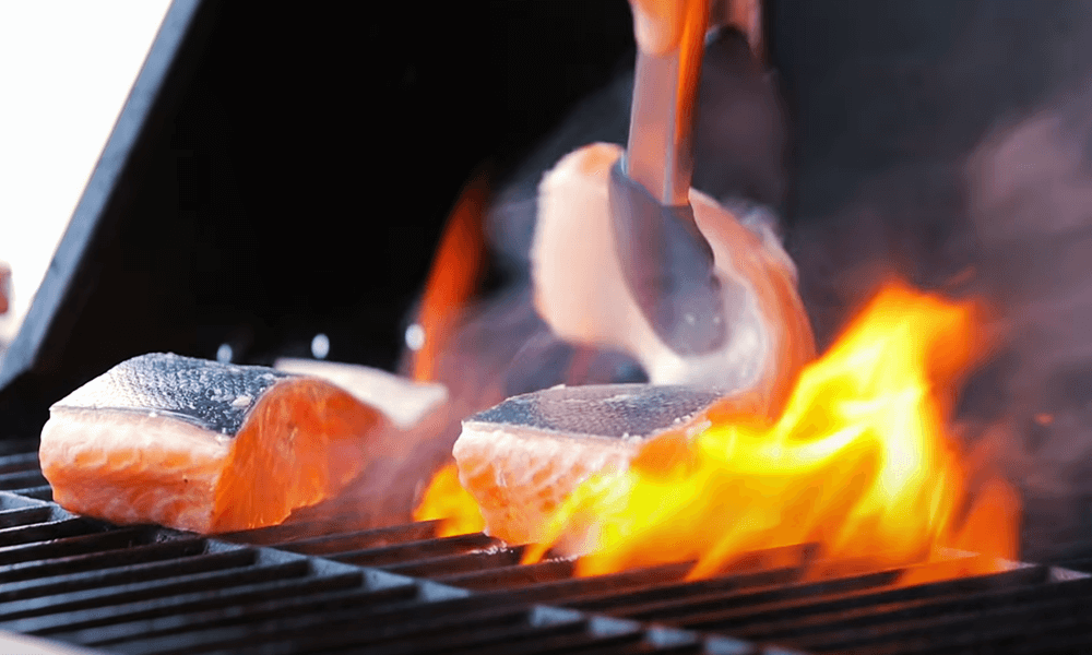 place the salmon onto the hot grill skin
